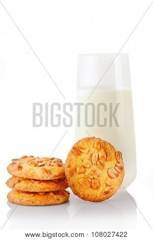 Stack of three homemade peanut butter cookies single cookie and glass of milk