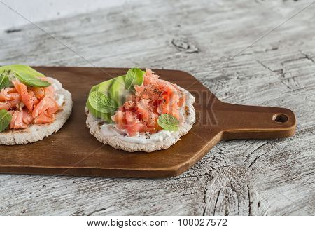 Whole Grain Tortilla With Avocado And Salmon, Served On A Wooden Board, Bright Wooden Surface. Rusti