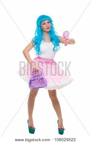 girl doll with blue hair. holding a mirror and handbag