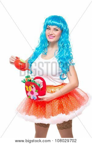 girl doll with blue hair. watering artificial flowers