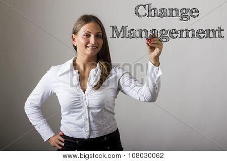Change Management - Beautiful Girl Writing On Transparent Surface