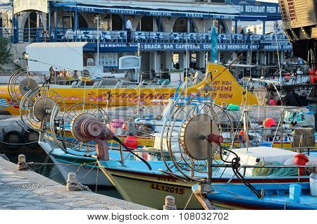Fishing boats and yachts moored in the fishing harbor