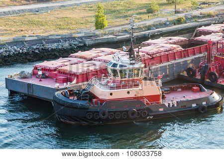 Tug Pushing Barge By Dock