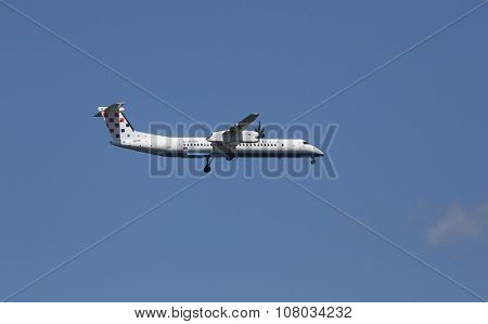 ZAGREB, CROATIA - JUNE 10: Bombardier DH8D, registration 9A-CQF of Croatia Airlines landing on Zagreb Airport Pleso on June 10, 2015.
