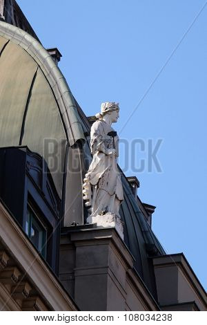 ZAGREB, CROATIA - FEBRUARY 15: Statue on top of the old city buildings on Ban Jelacic Square in Zagreb, Croatia on February 15, 2015