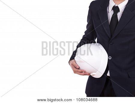 Engineer In Suit Holding Helmet