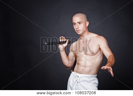 Man with nunchak
