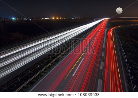 Speed Driving On Highway At Night Of Full Moon