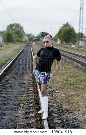 The Sexy Woman In White Boots And Sunglasses On Rails, Railway Tracks