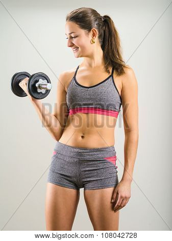 Happy Young Woman Doing Dumbbell Curl