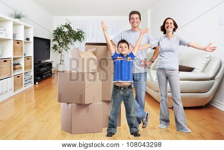 Happy family with moving boxes in new modern apartment.