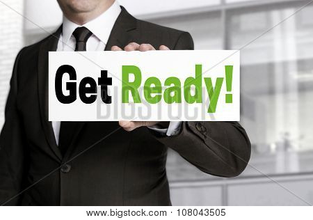 Get Ready Sign Is Held By Businessman Concept