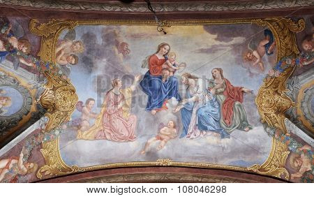 LJUBLJANA, SLOVENIA - JUNE 30: Virgin Mary with the baby Jesus surrounded by saints and angels, fresco in the Franciscan Church of the Annunciation in Ljubljana, Slovenia on June 30, 2015