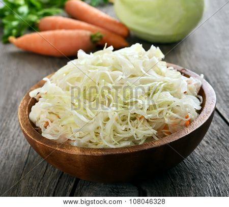 Sauerkraut In Wooden Bowl