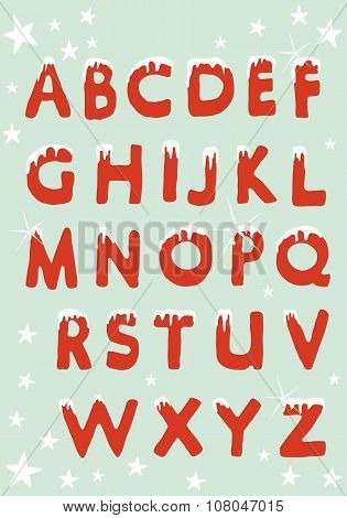 Alphabet with christmas capital letters hung with snow