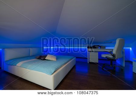 Bedroom In Luxury Loft Apartment - Shot In Low Light To Highlight The Atmosphere Of Blue Led Lights