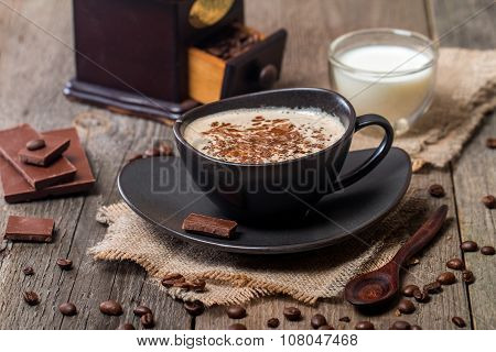 Cup Of Coffee With Coffee Beans And Chocolate