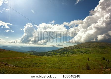 Beautiful Mountain Landscape With White Clouds In The Blue Sky