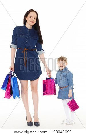 Happy Family With Shopping Bags.