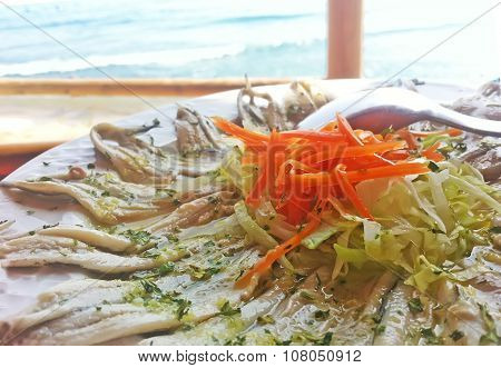 Marinated anchovies with olive oil and garlican carrot