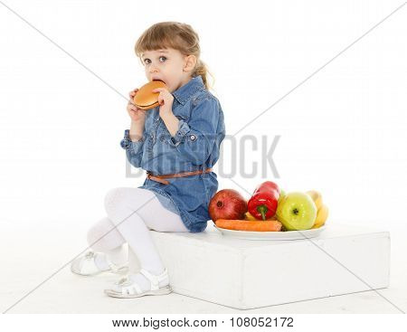 Child With Hamburger And Fruits.