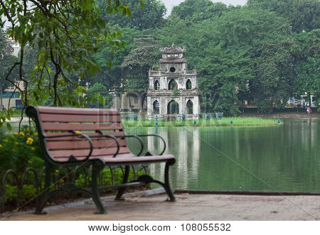 Autumn view of lake, tree and bench on the bank of Hoan Kiem (Sword) lake in Hanoi