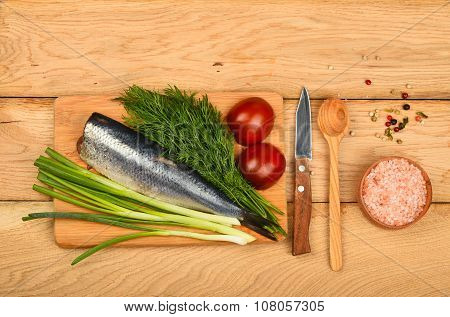 Herring Double Fillet With Vegetables On Wooden Table