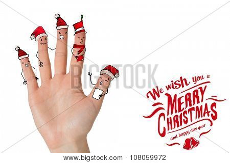 Christmas caroler fingers against christmas greeting