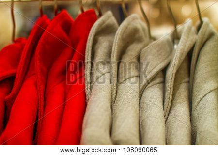 Female Coat Hangs On A Hanger In The Store