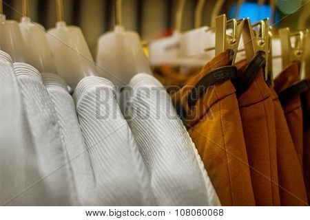 Blouses And Skirts Hanging On A Hanger In The Storec