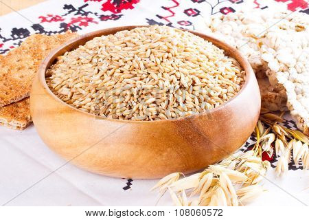 Oats In Wooden Bowl And Bread From Oats