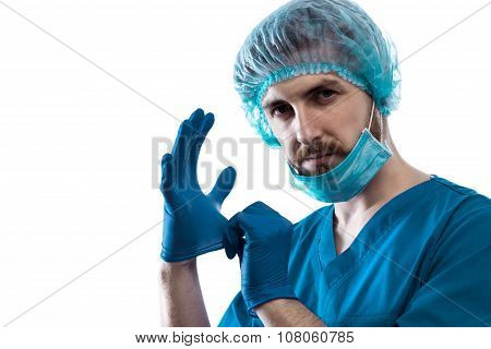 Man Doctor Surgeon Putting On Nitrile Gloves