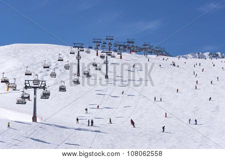 Skiers And Chairlifts In Solden, Austria
