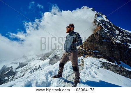 hiker at the top of a pass