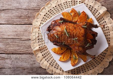 Delicious Roast Duck With Oranges On A Plate. Horizontal Top View