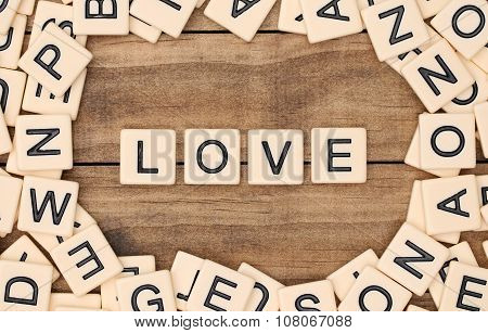 Love Spelled Out In Tan Tile Letters