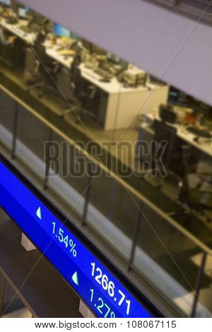 Display Stock Market Charts On Blue Neon Line With Blurred Office Background