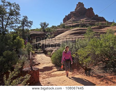 A Woman Hikes The Bell Rock Trail