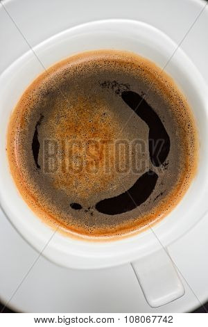 Cup of coffee closeup shot from above