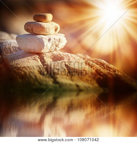 three stones lighted bright sun