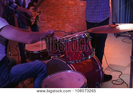 Musicians playing musical instruments on brick wall background
