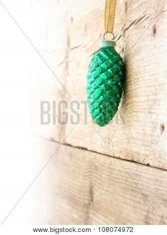 Christmas Decoration, Turquoise  Pine Cone  Hanging On A Wooden Wall, Background Faded To White