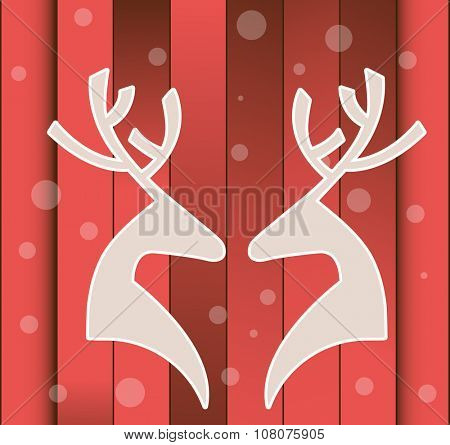 Two Deer Profiles facing each other over red planks