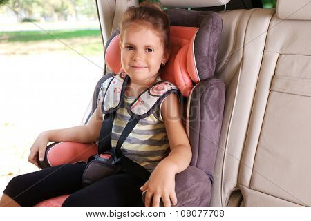 Adorable little girl in the car