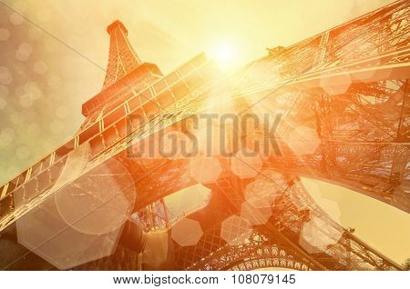 The Eiffel tower is one of the most recognizable landmarks in the world under sun light