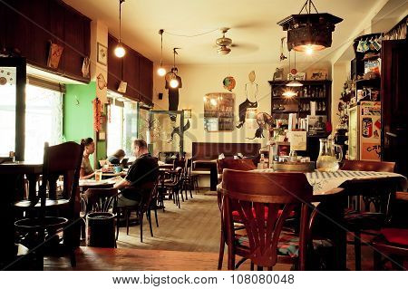 Interior Of Small Cafe With Wooden Chairs In The Style Of Old Apartment
