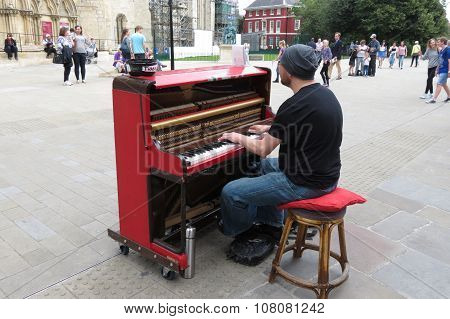 YORK UK - CIRCA AUGUST 2015: Karl Mullen street piano player performing as usual on the street of York