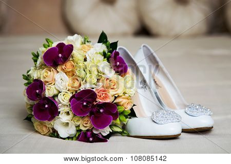 Vintage wedding bouquet orchids and roses with shoes