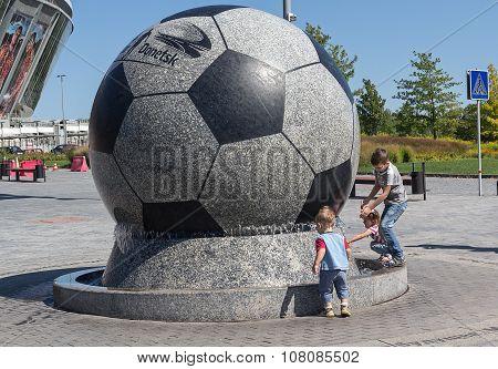 Donetsk, Ukraine - August 22, 2015: Children Playing Near The Fountain Stadium Donbass Arena During