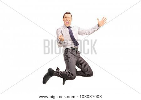 Full length portrait of a delighted businessman jumping and gesturing success shot in mid-air isolated on white background
